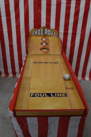Skee roll carnival game
